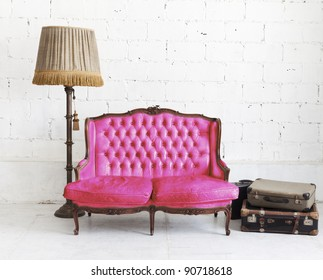 pink leather sofa in white room