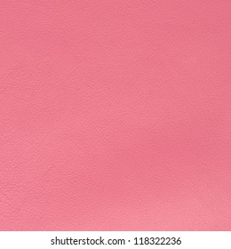 Pink leather texture closeup background.