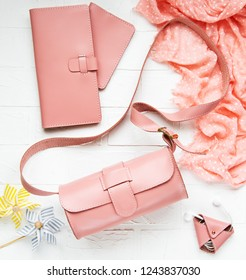 Pink leather woman bag and accessories - flat lay