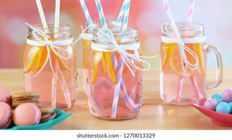 Pink lemonade in mason jars closeup on party table.