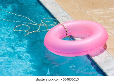 Pink life safer next to pool blue water