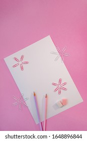 Pink and lilac stationery for school and office in pastel colors on a white background, top view, there is space for text. Back to school. The concept of creative school.