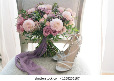 pink and lilac wedding bouquet stands on a chair
