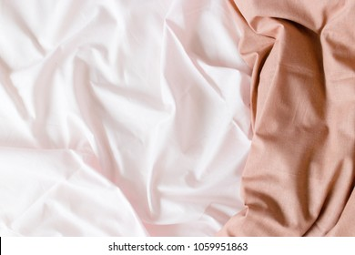Pink linens and brown blanket