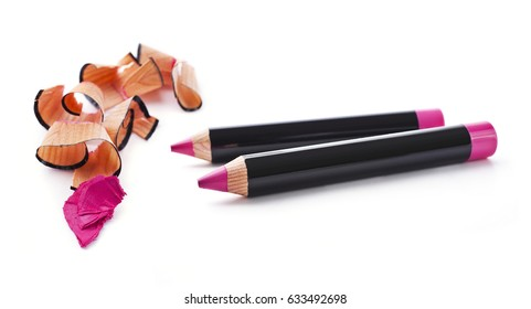 Pink lip pencils and shaving isolated on white background