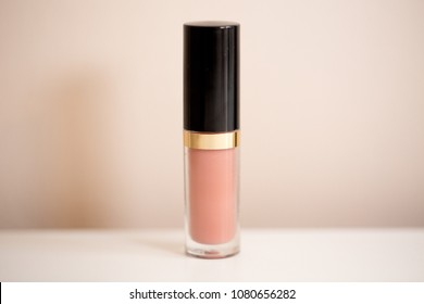 Pink lipstick isolated on white