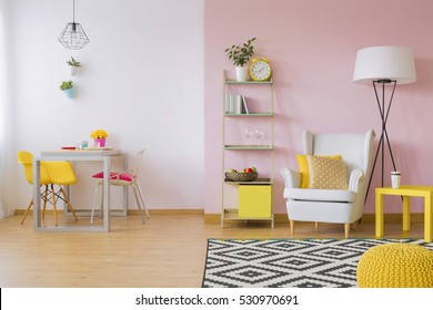 Pink living room with white and yellow furniture