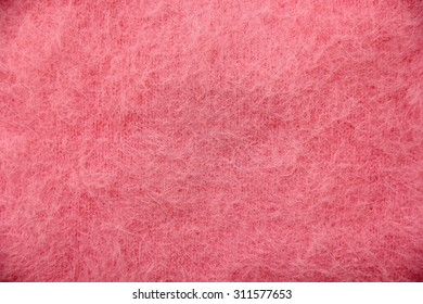Pink long hair wool knitting texture.