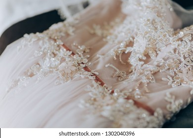 Pink luxury dress is getting ready for wedding. Morning preparations