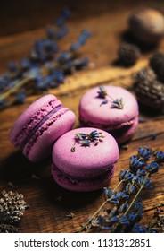 Pink macarons on a wood table