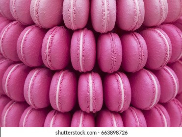 lot a ,pink macarons in a row background