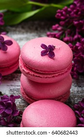 Pink macaroons and lilac. Selective focus