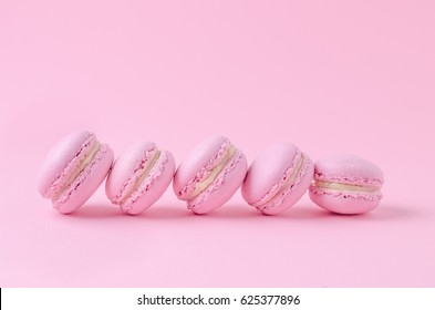 pink macaroons on pink background, homemade food