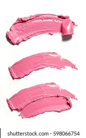 Pink makeup smears of lip gloss isolated on white background.