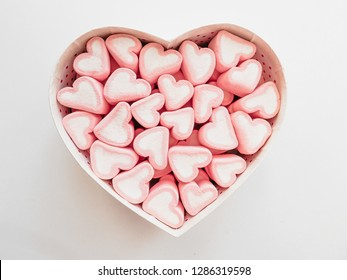 Pink marshmallow in a gift box in form of heart on white background, Many hearts marshmallows for present, Sweets in the form of hearts of marshmallow. Valentine's Day Gift