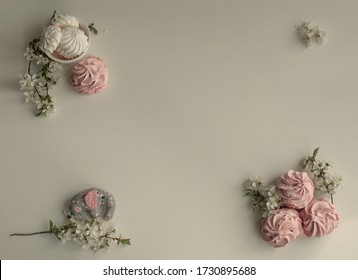 pink marshmallow with white flowers on a light background. spring background for the text. A gentle screensaver for the title. Wedding frame