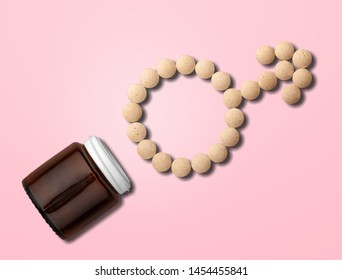 pink medicine tablets shaped as gender symbol and glass bottle on pink background, venus sign, top view, flat lay