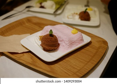 Pink milk kakigori or korea shaved ice dessert flavored with ice cream chocolate