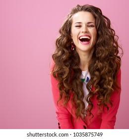 Pink Mood. happy modern woman with long wavy brunette hair isolated on pink background