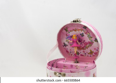 pink musical jewelry box with flower decoration and a pretty pink ballerina on a white background