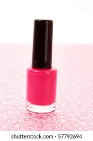 Pink nail polish on white background