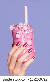 Pink Nails. Woman With Soda Can In Hands On Purple Violet Background. Close Up Of Female Hands WIth Bright Manicure Holding Pink Soda Can With Beads. Nails Design. High Quality Image.