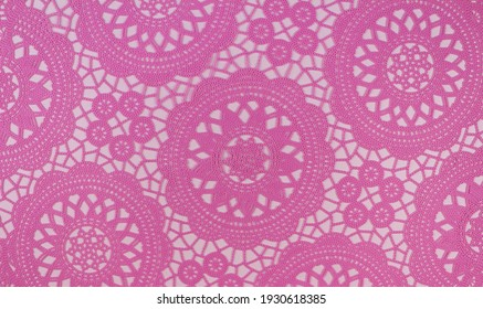 Pink openwork wicker background with white holes