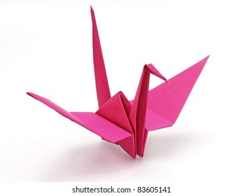 Pink origami bird on white background
