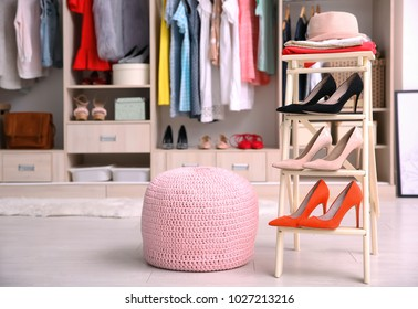 Pink Ottoman Chair And Stand With Shoes In Dressing Room