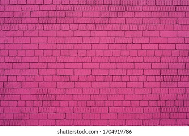 Pink painted brick wall with dots background.