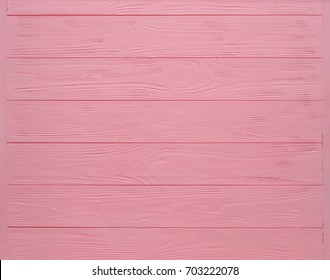 Pink painted wood board texture and background. Pink natural wooden background. Aged wood planks pattern. Wooden surface. Wooden barn. Pink color wood barn. Woodboard background.