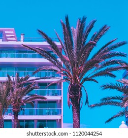 pink palm trees  and hotel against the blue sky. bright neon colors. minimal and surreal. summer vacation. urban style. 80s style