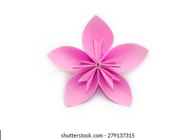 Pink paper origami flower on white background
