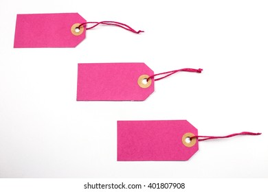 Pink Paper Tags Tied with String.