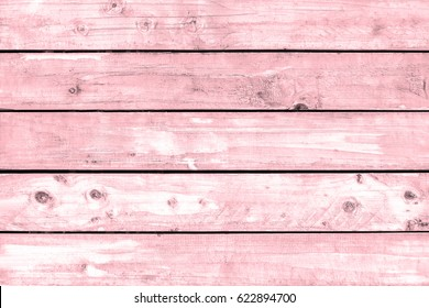 Pink pastel wood plank floor texture background. White oak timber top table.