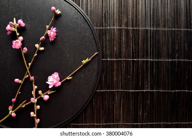 Pink peach blossoms on the black tray.Image of Japanese style flower arrangement on spring season