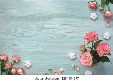 Pink pearl hyacinth flowers on colored background with decorative ceramic flowers, copy-space