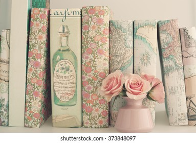 Pink peonies and books