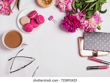 Pink peonies, coffee with milk and cute feminine accessories on the white background