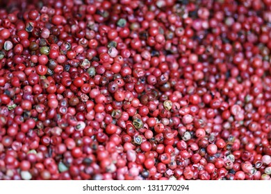 Pink peppercorn close up shot with selective focus.