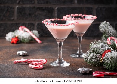Pink peppermint martini with candy cane rim. Christmas cocktail