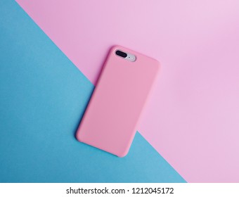 Pink phone case back view. Template of iphone 8 plus case. Blue and pink background