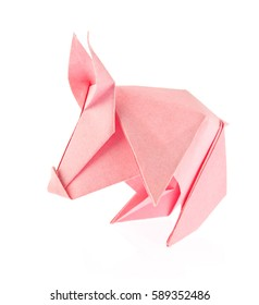 Pink pig of origami. Isolated on white background