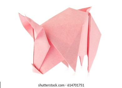 Pink pig of origami, isolated on white background.