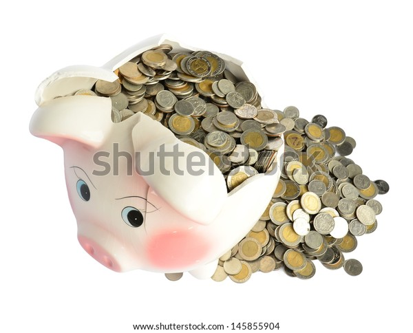 Pink piggy bank broken with money isolated on white background