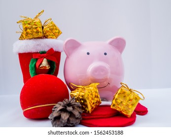 Pink Piggy Bank and Christmas boot with decoration on white background, Have a nice holiday on this Christmas.
