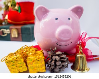 Pink piggy bank  with christmas decoration on white background, Have a nice holiday on this Christmas.