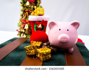 Pink piggy bank and Christmas tree with decoration on white background, Have a nice holiday on this Christmas.
