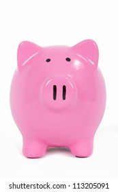 Pink piggy bank front view, isolated on white background.