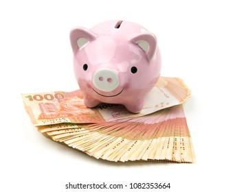 Pink piggy bank and Hong Kong dollar currency notes isolated on white background.